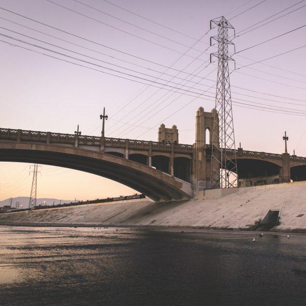 brown bridge under gray sky